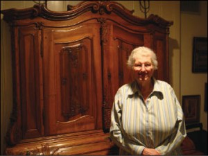 <p>Photo: Rachel Gross Renate Kahn is shown in her Dallas home. The armoire behind her is the only valuable item her family was able to bring with them when they left Germany shortly after Kristallnacht.</p>