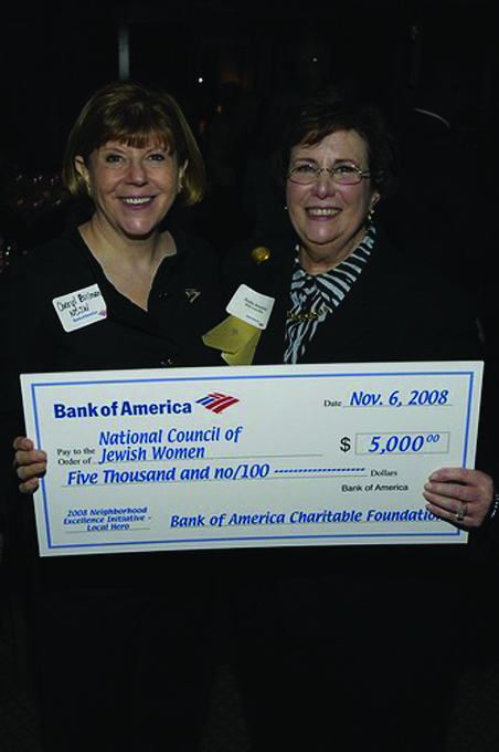 <p>Cheryl Bollman of National Council of Jewish Women accepts a $5,000 donation from Local Hero Phyllis Bernstein.</p>